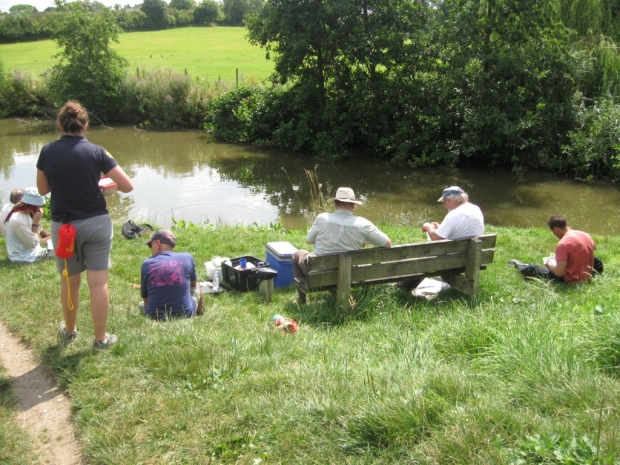 People having a picnic by the canal